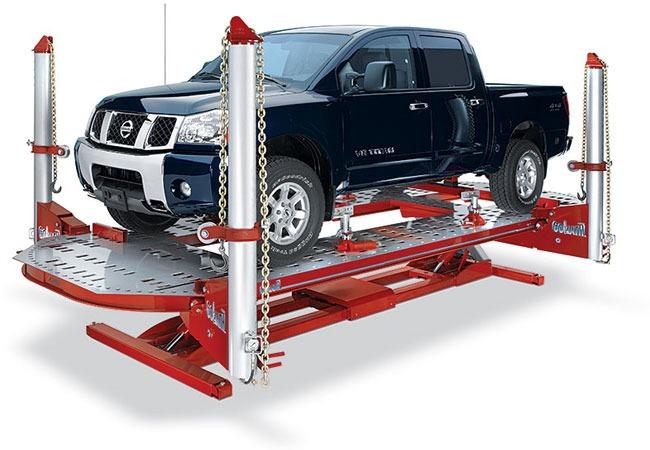 Truck sitting on a platform.
